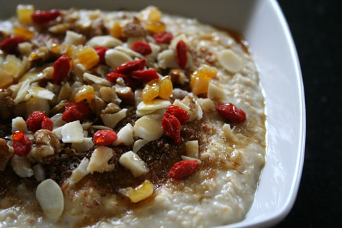 Porridge with nuts, gojis and candied citrus peel