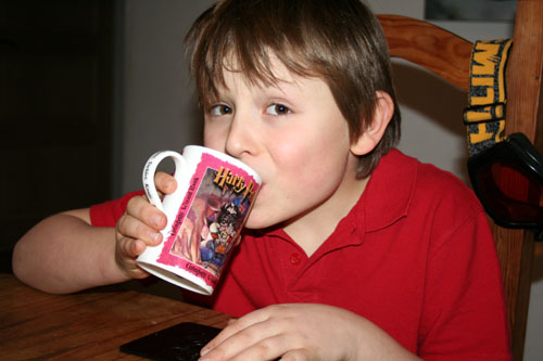 Lil L drinking hot choc