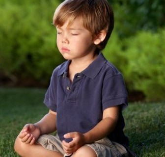 boy-meditating-in-grass-e1351194334983